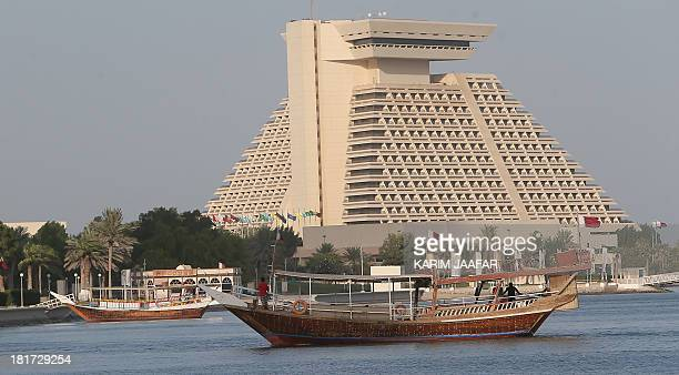 A dhow is anchored in front a hotel off the coast of the Qatari capital Doha on September 22 2013 Three months after a new emir Sheikh Tamim bin...