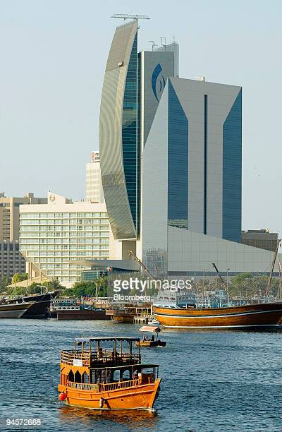 Dhow passes in front of the Dubai Chamber of Commerce right and the National Bank of Dubai left along the Dubai Creek on Sunday Nov 4 2007 The Dubai...