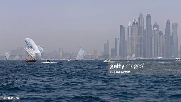 TOPSHOT Dhows participate in the alGaffal traditional longdistance dhow sailing race near the finish line off of Dubai on May 14 after starting from...