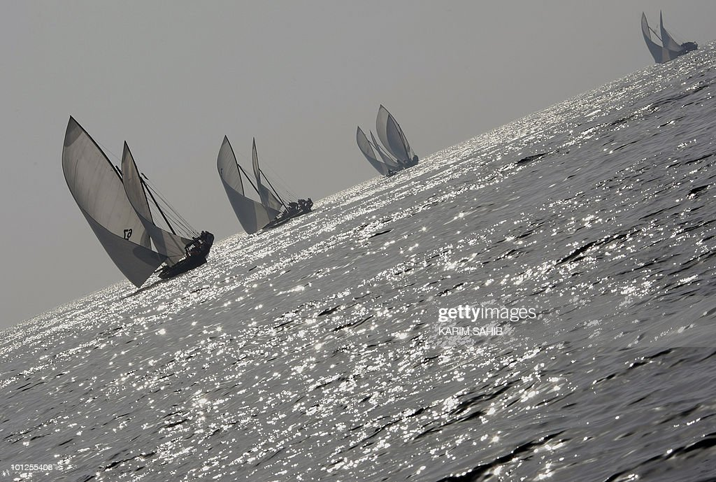 Dhows sail in the Gulf during the Al-Gaffal 60 ft traditional dhow sailing race between the island of Sir Bu Nair, near the Iranian coast, and the Gulf emirate of Dubai on May 29, 2010.