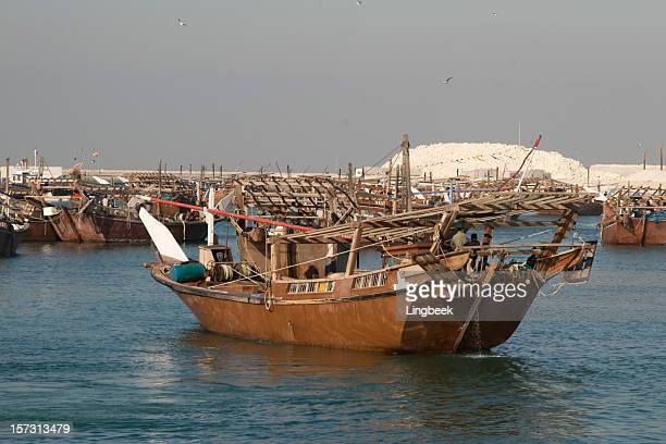 Dhows sailing out of Bahrain.