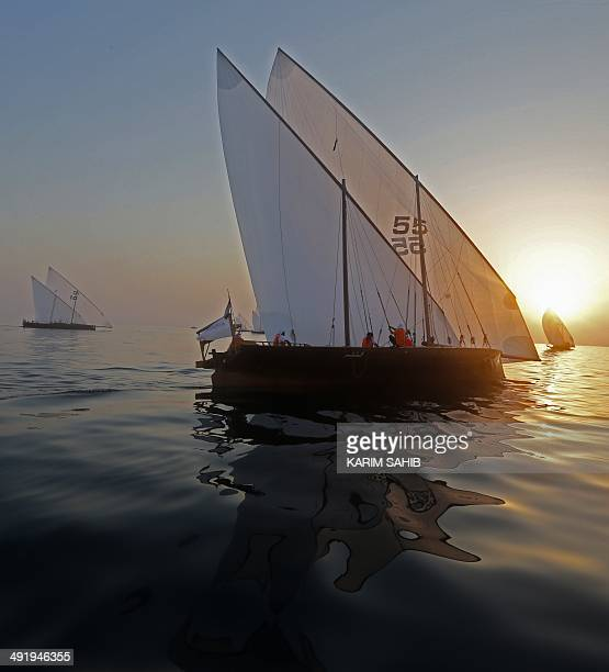 Dhows sails during the AlGaffal traditional longdistance dhow race towards the finish line as they race between the island of Sir Bu Nair near the...