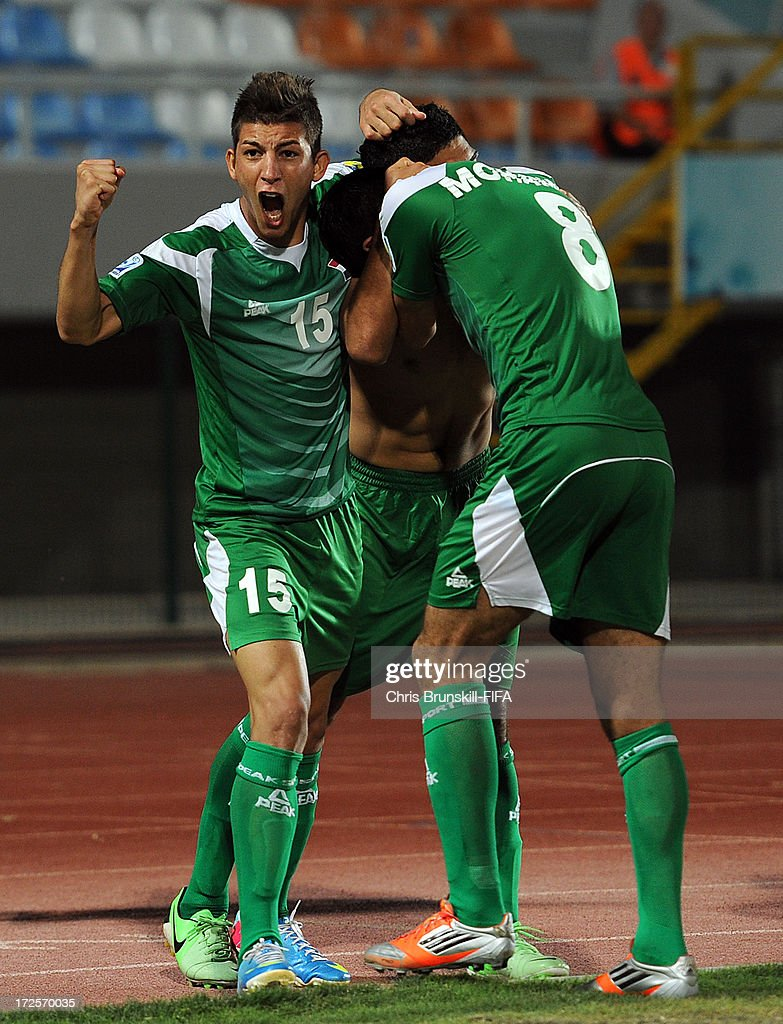 Dhurgham Ismael (L) of Iraq celebrates his side's first goal with goal scorer Farhan Shakor (C) during the FIFA U20 World Cup Round of 16 match between Iraq and Paraguay at Akdeniz University Stadium on July 03, 2013 in Antalya, Turkey.