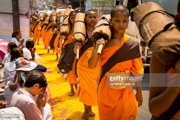 Dhutanga monks led a procession on paths of flower pedals through CHiang Mai Thailand to offer reverence to the Buddhas relics and to bless the city