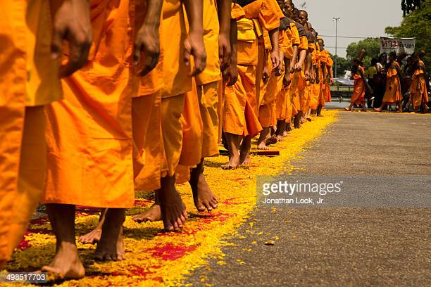 Dhutanga monks led a procession on paths of flower pedals through Chiang Mai to offer reverence to the Buddhas relics and to bless the city