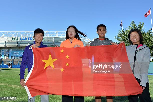 Di Wu Ying Ying Duan Ze Zhang and Hao Chen Tang of China pose with the national flag in front of Rod Laver Arena ahead of the 2014 Australian Open at...
