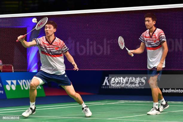 Di Zijian and Wang Chang of China compete against Mahiro Kaneko and Yunosuke Kubota of Japan during Men's Doubles Final match of the BWF World Junior...