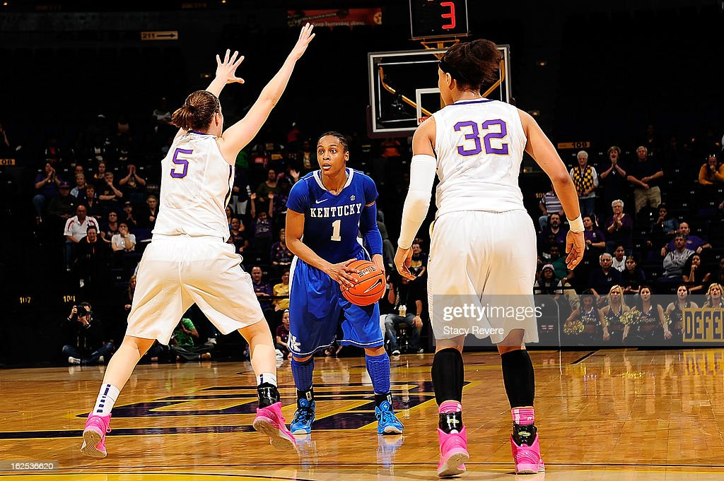 A'dia Mathies of the Kentucky Wildcats is defended by Jeanne Kenney and Danielle Ballard of the LSU Tigers during a game at the Pete Maravich...
