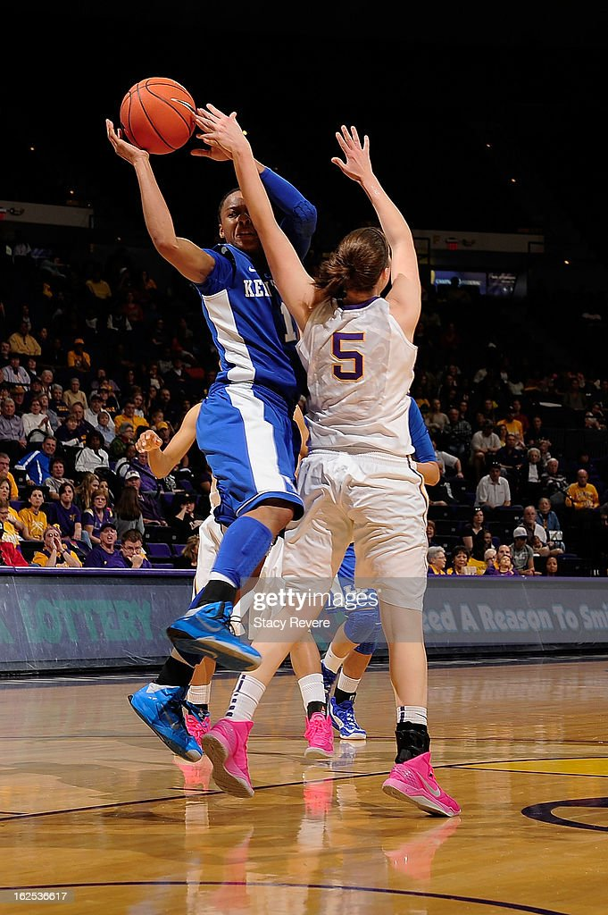 A'dia Mathies of the Kentucky Wildcats is defended by Jeanne Kenney of the LSU Tigers during a game at the Pete Maravich Assembly Center on February...