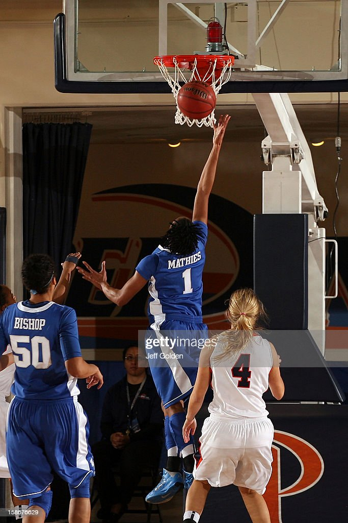A'dia Mathies of the Kentucky Wildcats shoots a layup against Grace Leah Baughn of the Pepperdine Waves at Firestone Fieldhouse on December 18 2012...