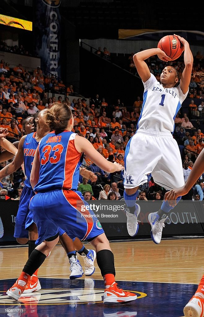 A'dia Mathies of the Kentucky Wildcats takes a shot over Jordan Jones of the Florida Gators during the quarterfinals of the SEC Women's Basketball...