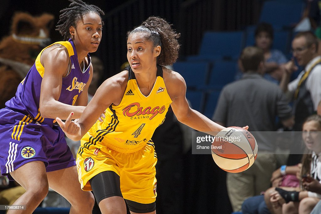 A'dia Mathies of the Los Angeles Sparks defends Skylar Diggins of the Tulsa Shock during the WNBA game on September 6 2013 at the BOK Center in Tulsa...