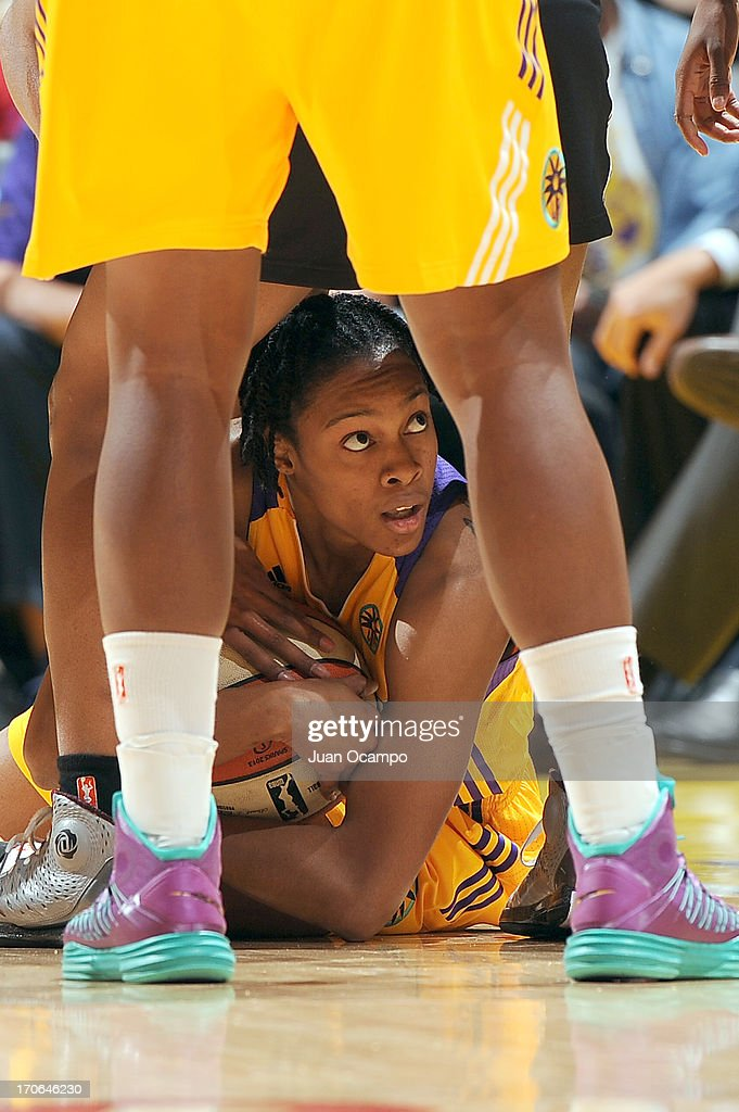 A'dia Mathies of the Los Angeles Sparks dives for a loose ball during the game between the San Antonio Silver Stars and the Los Angeles Sparks at...