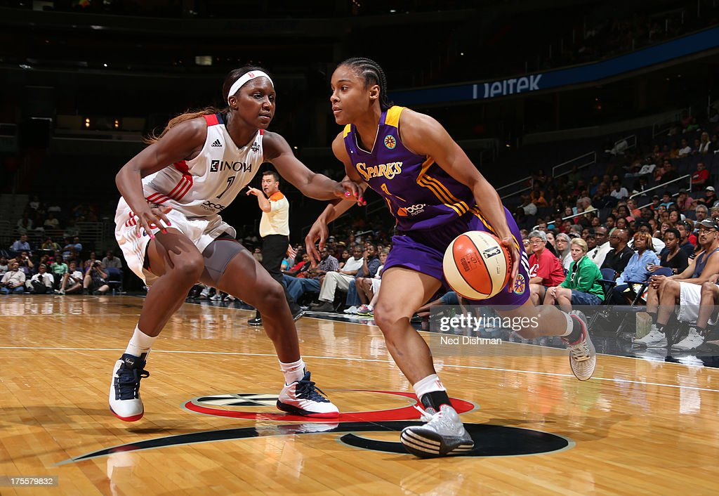 A'dia Mathies #1 of the Los Angeles Sparks drives against Crystal Langhorne #1 of the Washington Mystics at the Verizon Center on August 4, 2013 in Washington, DC.