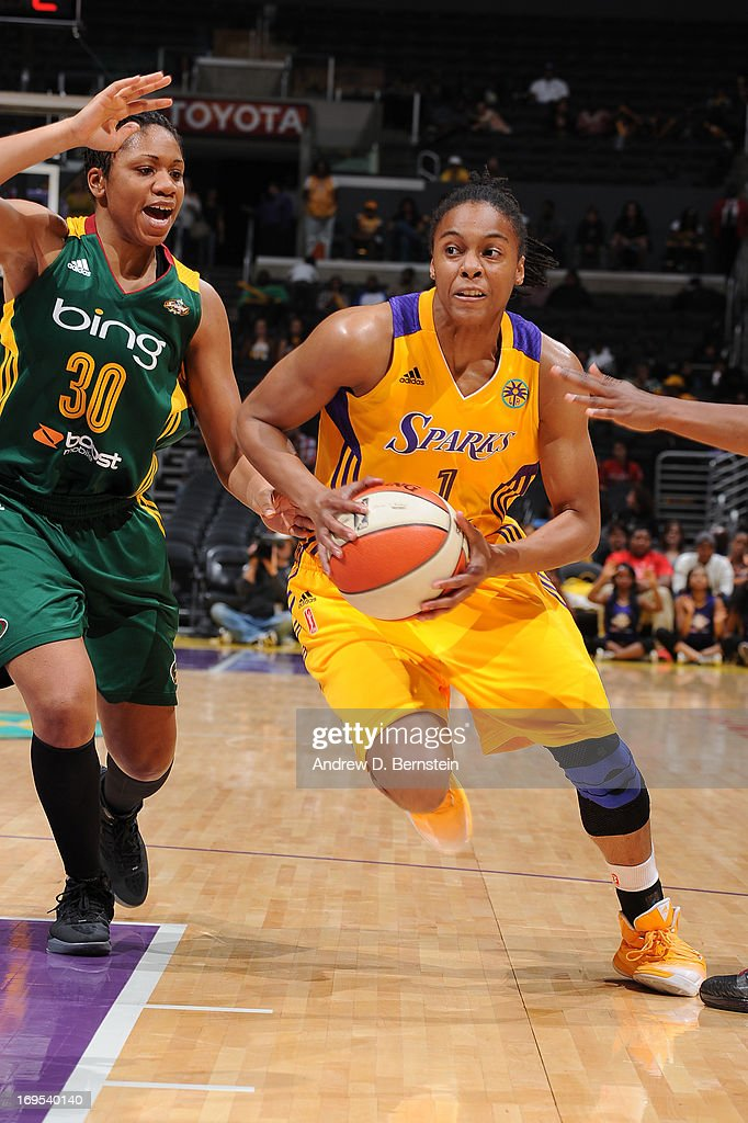 A'dia Mathies of the Los Angeles Sparks drives to the basket during a game against the Seattle Storm at Staples Center on May 26 2013 in Los Angeles...