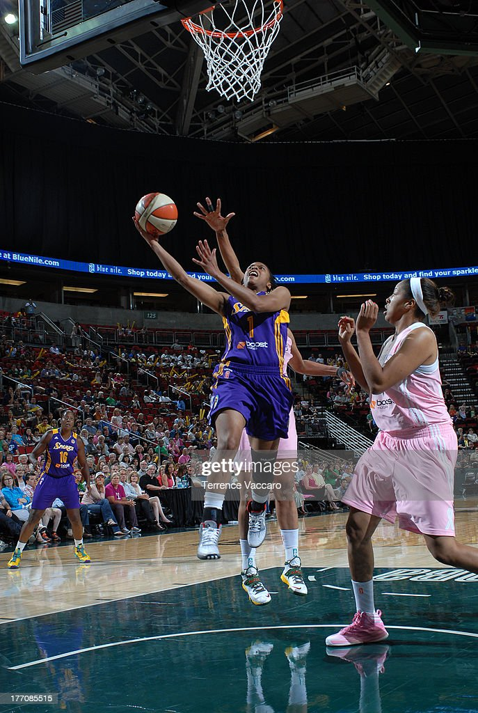 A'dia Mathies #1 of the Los Angeles Sparks goes to the basket against Tianna Hawkins #21 of the Seattle Storm during the game on August 20, 2013 at Key Arena in Seattle, Washington.