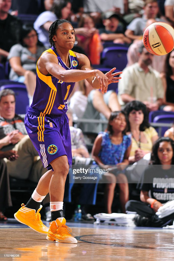 A'dia Mathies of the Los Angeles Sparks passes the ball against the Phoenix Mercury on June 14 2013 at US Airways Center in Phoenix Arizona NOTE TO...