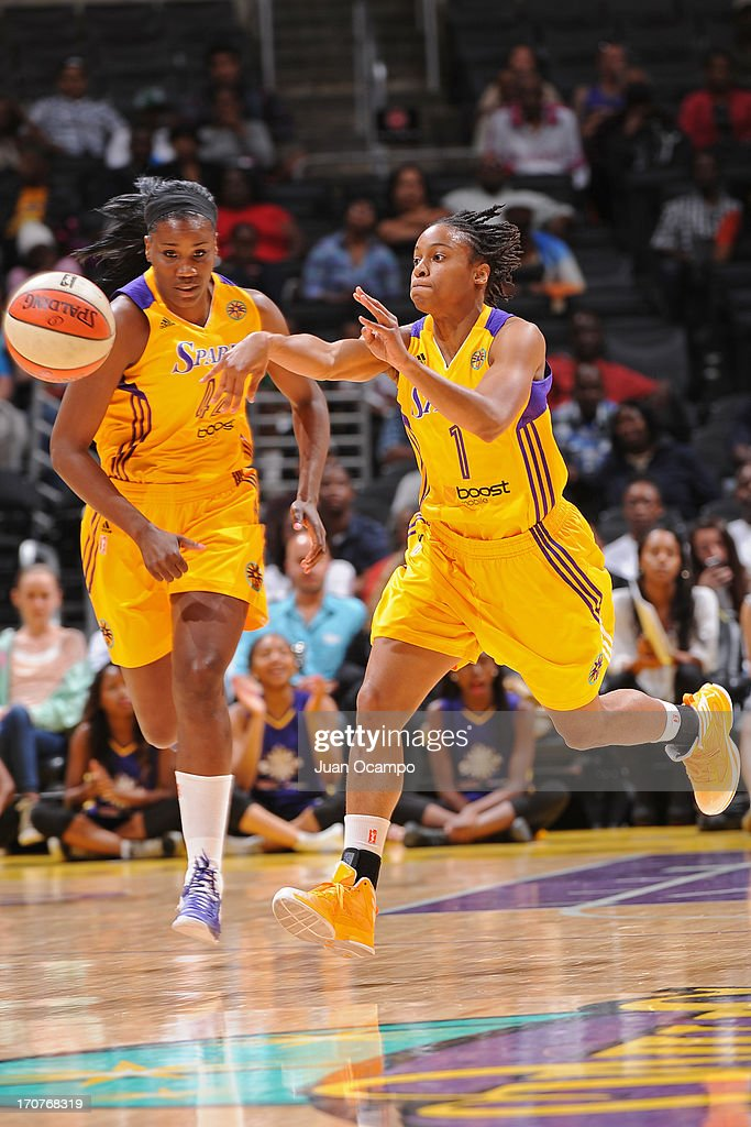 A'dia Mathies of the Los Angeles Sparks passes the ball against the San Antonio Silver Stars at Staples Center on June 15 2013 in Los Angeles...