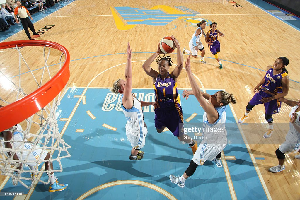 A'dia Mathies #1 of the Los Angeles Sparks shoots against Courtney Vandersloot #22 and Elena Delle Donne #11 of the Chicago Sky during the game on June 29, 2013 at the Allstate Arena in Rosemont, Illinois.