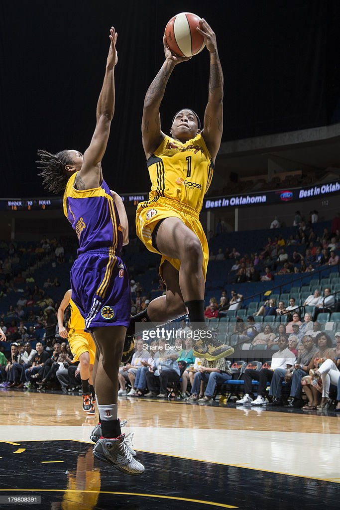 A'dia Mathies of the Los Angeles Sparks tries to get a hand on a shot by Riquna Williams of the Tulsa Shock during the WNBA game on September 6 2013...