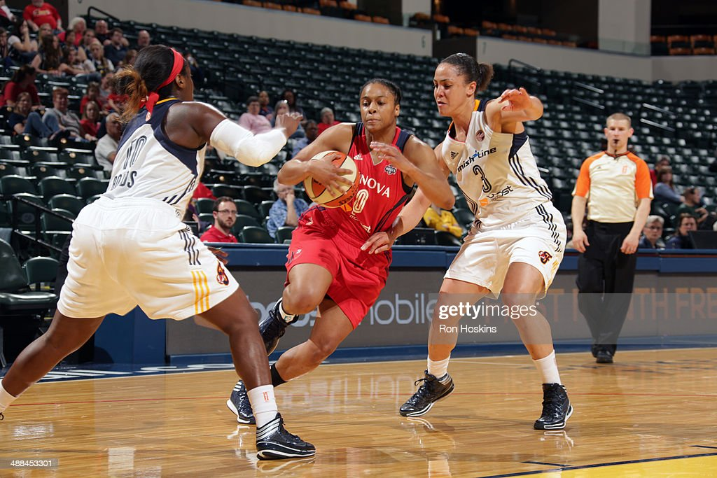 A'dia Mathies of the Washington Mystics handles the ball against the Indiana Fever during the WNBA preseason game on May 6 2014 at Bankers Life...