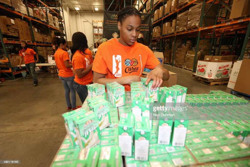 A'dia Mathies of the Washington Mystics participates during an WNBA Carers event at the Capital Food Bank on May 12 2014 in Washington DC NOTE TO...