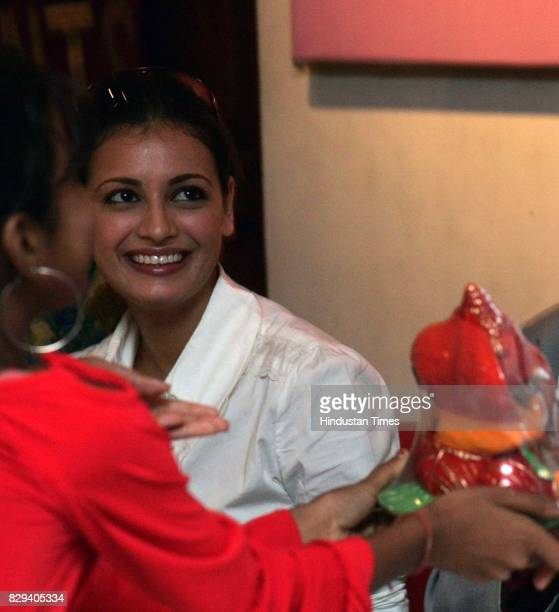 Dia Mirza smiles as a canceraffected child walks up to meet the celebrities at a special celebration for children suffering from cancer on the eve of...