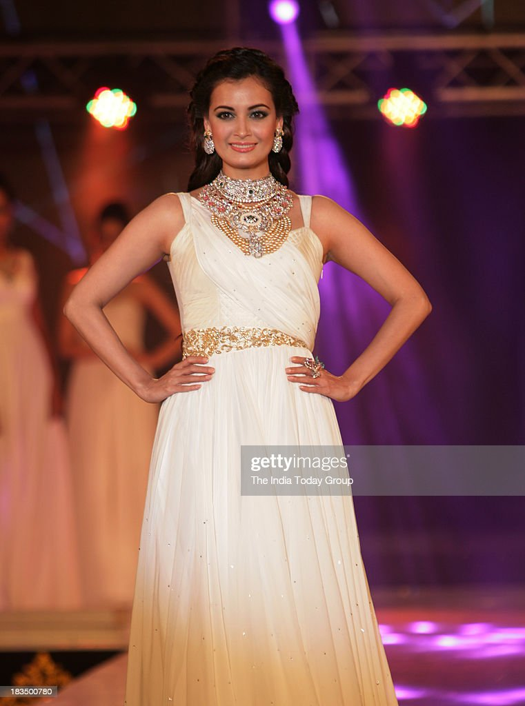 Dia Mirza walks the ramp during a fashion show organised by India International Bullion Summit showcasing exquisite jewellery.