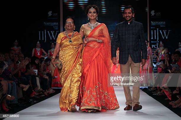 Dia Mirza walks the runway with Shobha Choksey Snehal Choksey during day 1 of the India International Jewellery Week 2014 at grand Hyatt on July 14...