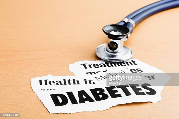 Diabetes headlines with stethoscope on desk