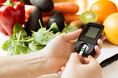 Diabetes monitor, diet and healthy food eating nutritional concept with clean fruits and vegetables with diabetic measuring tool kit