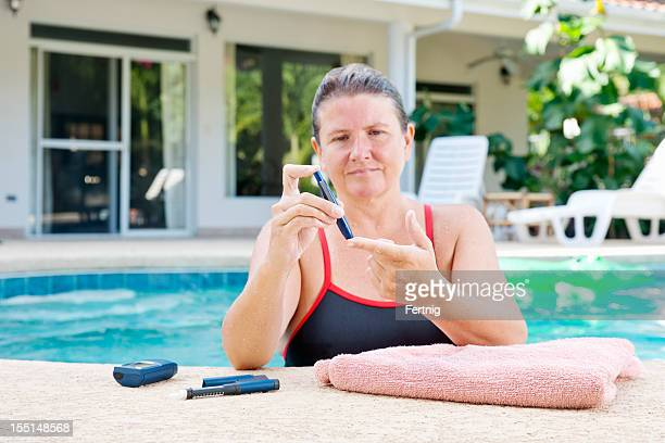 Diabetes patient checking her blood sugar before or after excercising