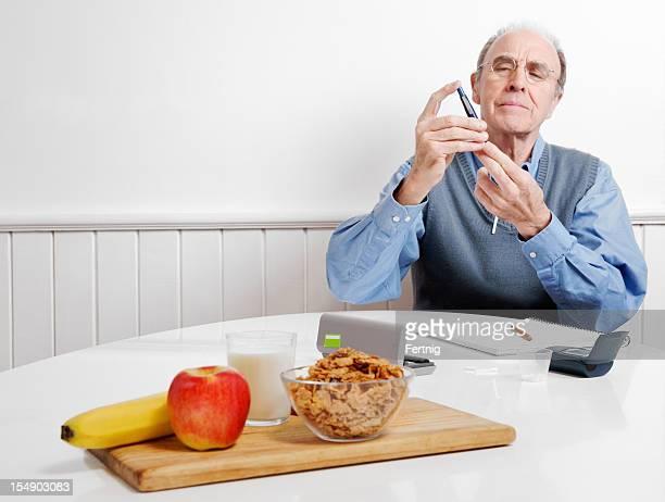 Diabetes patient testing his blood sugar