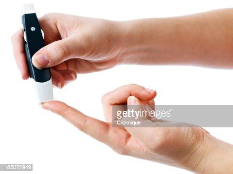Diabetic administering finger-prick test for blood sugar