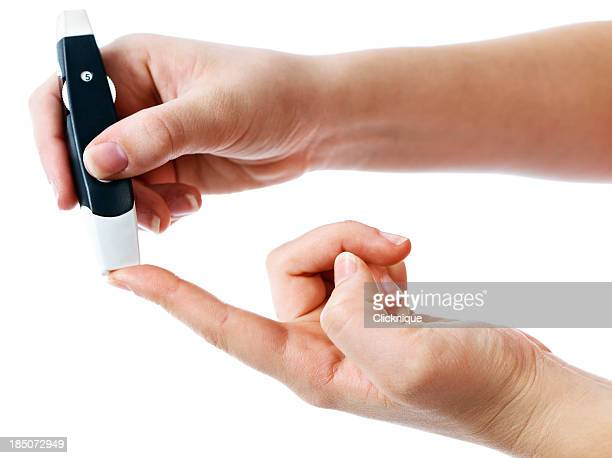 Diabetic administering finger-prick test for blood sugar