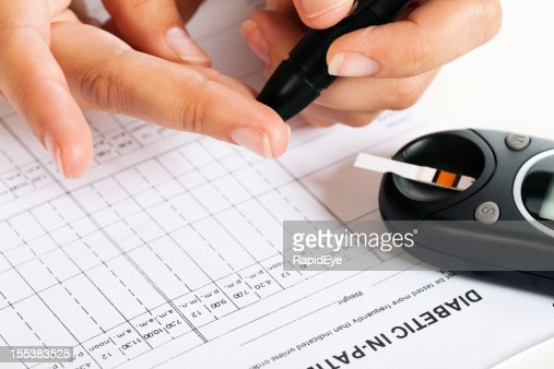 Diabetic drawing blood to test blood-sugar levels