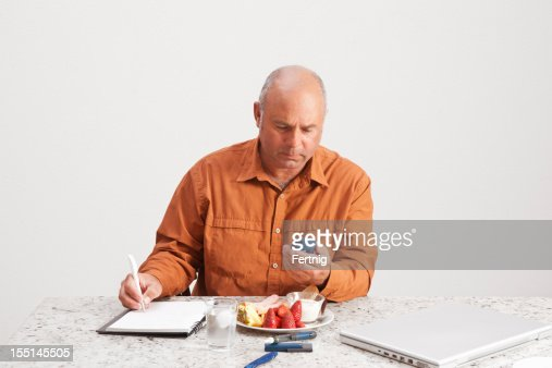 Diabetic man checking his levels