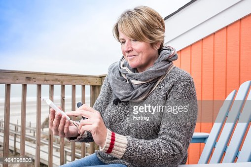 Diabetic patient testing her blood at the beach