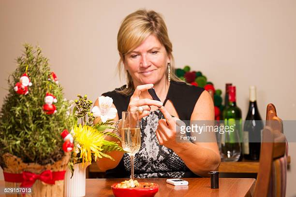 Diabetic woman checking her blood glucose levels at Christmas