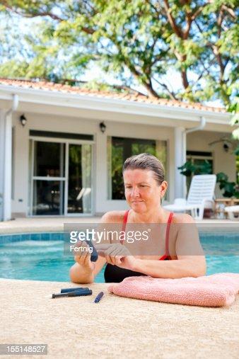 Diabetic woman testing her blood sugar
