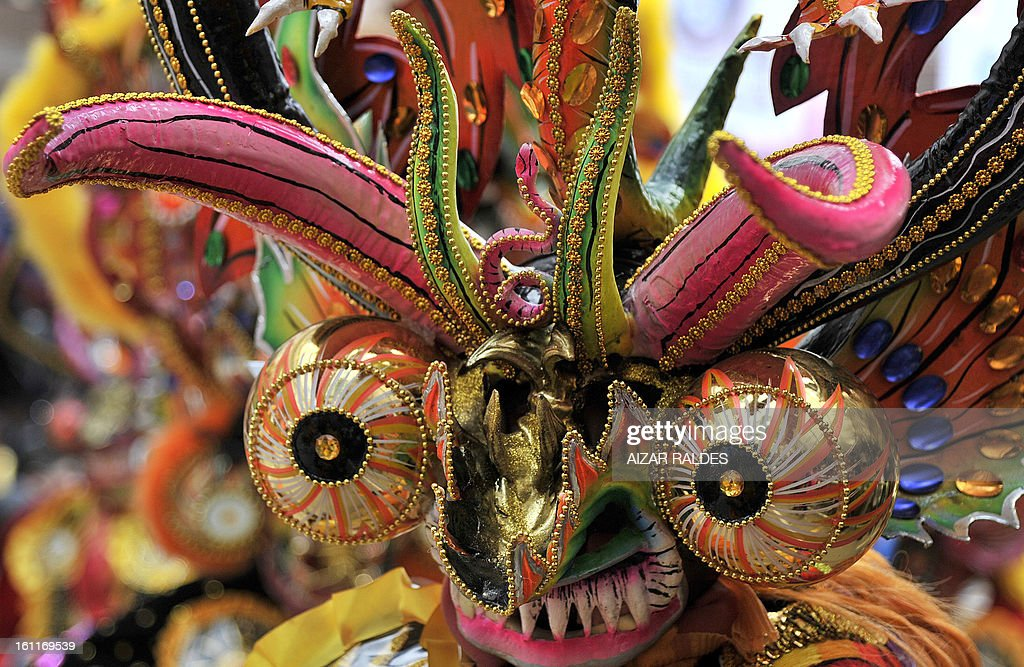 A Diablada brotherhood dancer performs during the Carnival of Oruro, in the mining town of Oruro, 240 km south of La Paz on February 9, 2013. The Carnival of Oruro was inscribed by UNESCO on the Representative List of the Intangible Cultural Heritage of Humanity in 2008.