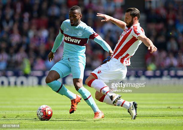 Diafra Sakho of West Ham United and Erik Pieters of Stoke City compete for the ball during the Barclays Premier League match between Stoke City and...
