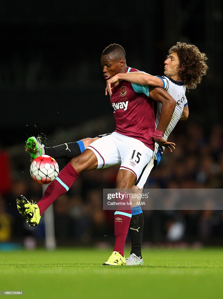 Diafra Sakho of West Ham United and Fabricio Coloccini of Newcastle United during the Barclays Premier League match between West Ham United and Newcastle United on September 14, 2015 in London, United Kingdom.