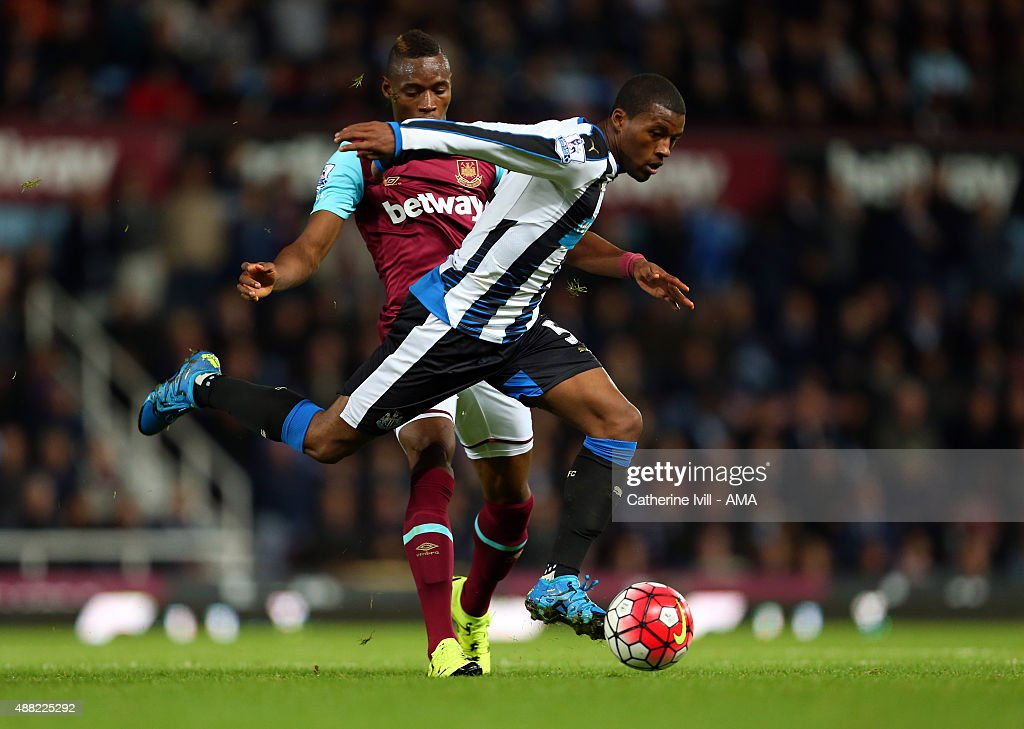 Diafra Sakho of West Ham United and Georginio Wijnaldum of Newcastle United during the Barclays Premier League match between West Ham United and Newcastle United on September 14, 2015 in London, United Kingdom.