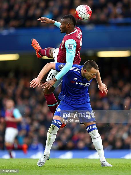 Diafra Sakho of West Ham United and John Terry of Chelsea compete for the ball during the Barclays Premier League match between Chelsea and West Ham...