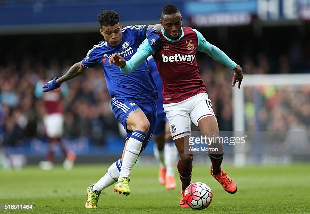 Diafra Sakho of West Ham United and Kenedy of Chelsea compete for the ball during the Barclays Premier League match between Chelsea and West Ham...