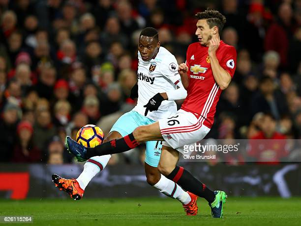 Diafra Sakho of West Ham United and Matteo Darmian of Manchester United battle for possession during the Premier League match between Manchester...