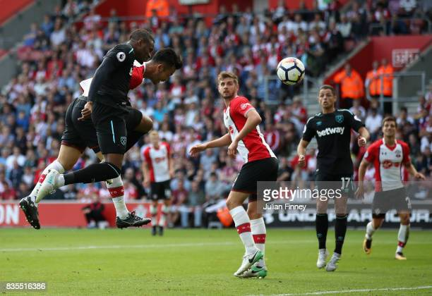 Diafra Sakho of West Ham United and Maya Yoshida of Southampton battle for possession in the air during the Premier League match between Southampton...