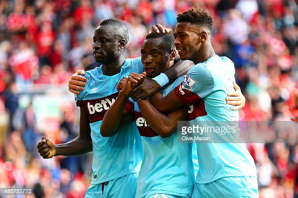 Diafra Sakho of West Ham United celebrates scoring his team's third goal with his team mates Cheikhou Kouyate and Reece Oxford during the Barclays...
