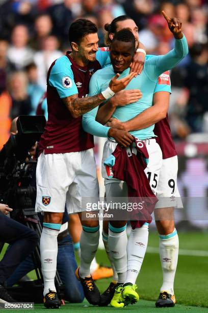 Diafra Sakho of West Ham United celebrates scoring the opening goal with his team mates during the Premier League match between West Ham United and...